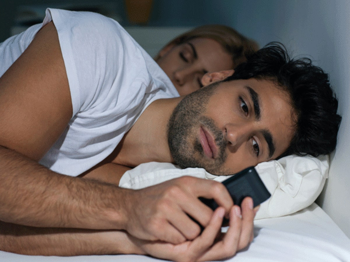 man cheating on a cell phone